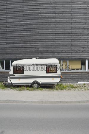 caravan and wooden wall