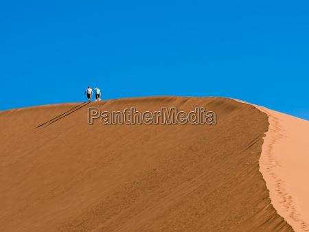africa namibia sossusvlei two people hiking
