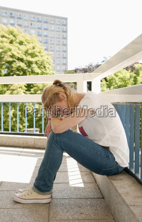 germany berlin depressed young woman sitting
