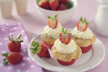 strawberry muffins with mascarpone topping on