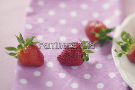 strawberries on pink cloth