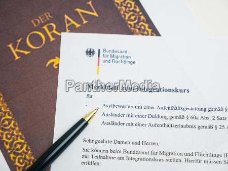 koran and german document for naturalization