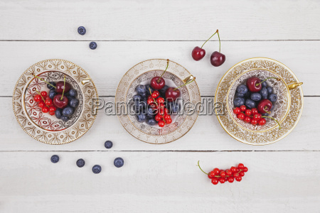 collectors cups with blueberries red currants