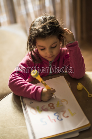 little girl drawing numbers