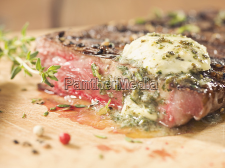 rump steak with herb butter on
