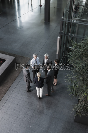 group of businesspeople with laptop talking
