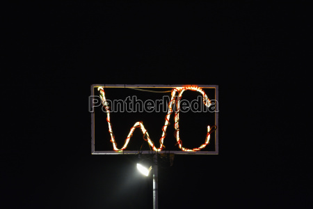 illuminated german sign of toilet in