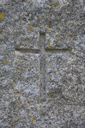 symbol of christianity carved in granite