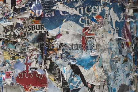 germany bavaria regensburg torn posters on