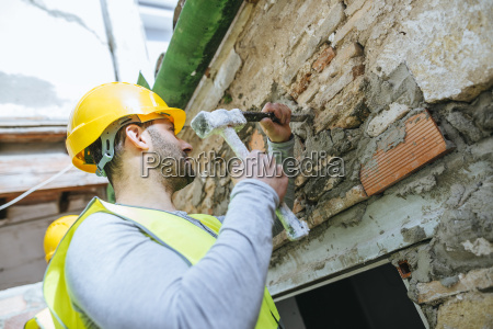 construction worker working with hammer and