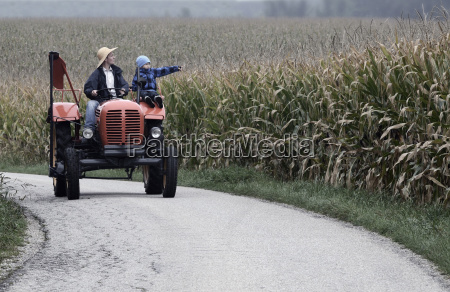 austria farmer and his son driving