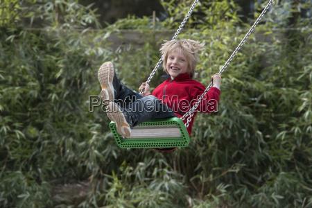 austria linz boy swinging on swing