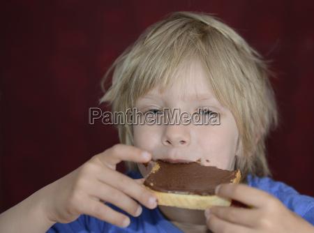 austria boy eating breakfast looking tired