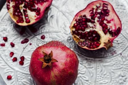 pomegranates punica granatum on silver tray