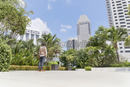 singapore man standing on terrace of
