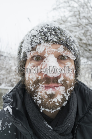 portrait of man with snow in