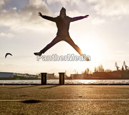 germany hamburg man jumping from pole