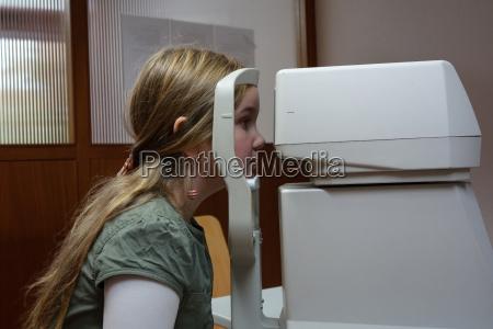 germany freiburg girl having eye test