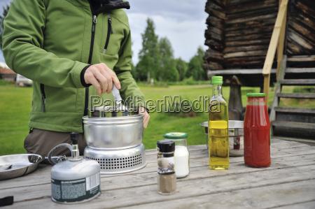 sweden leksand man cooking pasta on