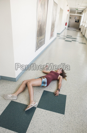 austria student lying on floor