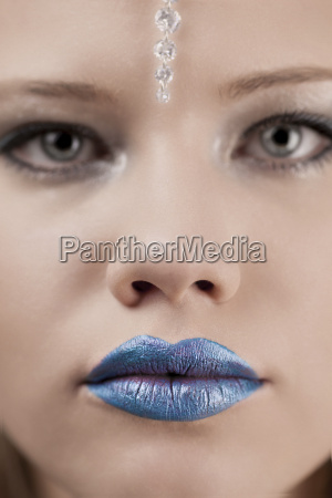 young woman with blue lips