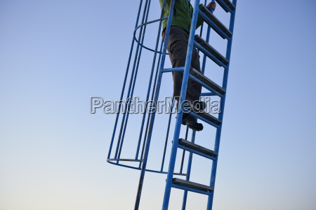 sweden storuman man climbing on ladder