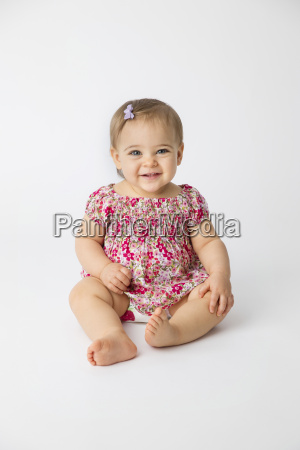 portrait of smiling baby girl wearing