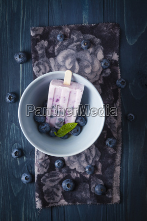 bowl of blueberry yogurt with candy