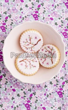 painted pink sugar cookies in bowl