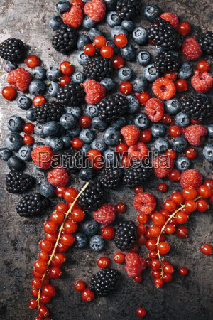 berries on old metal tray