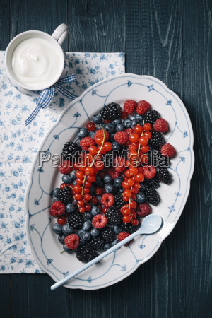berries on serving plate with cup