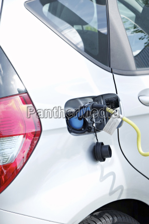 electric vehicle is being charged