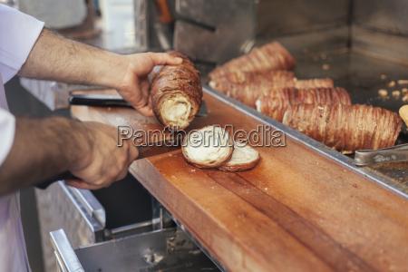 turkey istanbul mans hands preparing kokorec