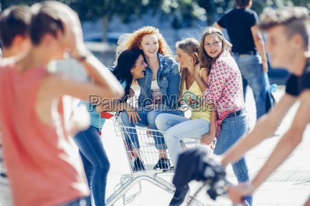 four female friends with shopping cart