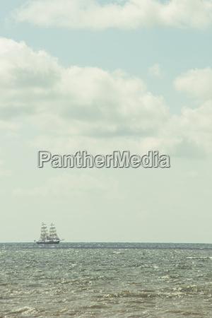 sailing ship at horizon