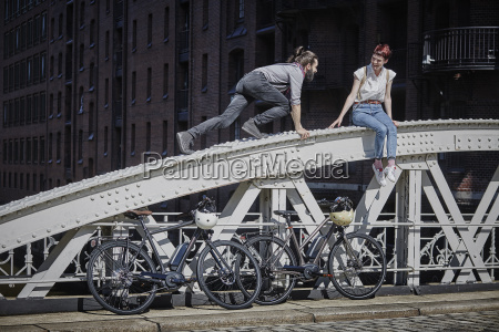 germany hamburg couple with electric bicycles