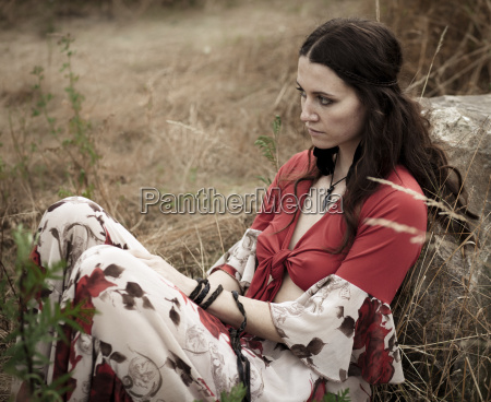 dark haired young woman outdoors