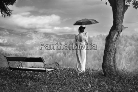 woman with umbrella in nature