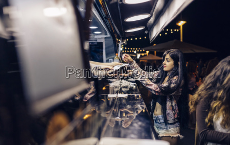 young woman taking food of food