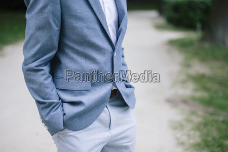 man at wedding standing with hands