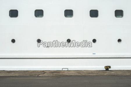 rows of portholes of white cruise