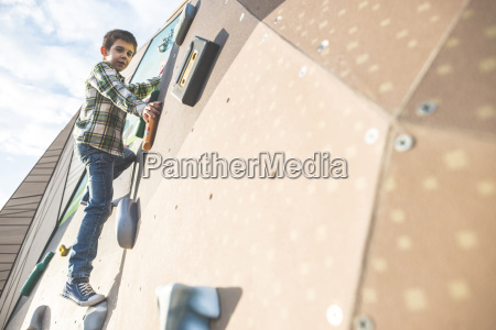 boy at climbing wall on a
