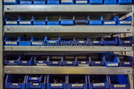 many boxes with screws in workshop