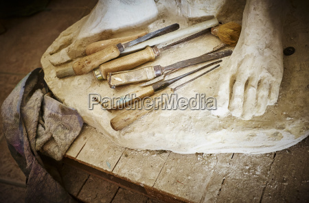chisels on base of stone sculpture