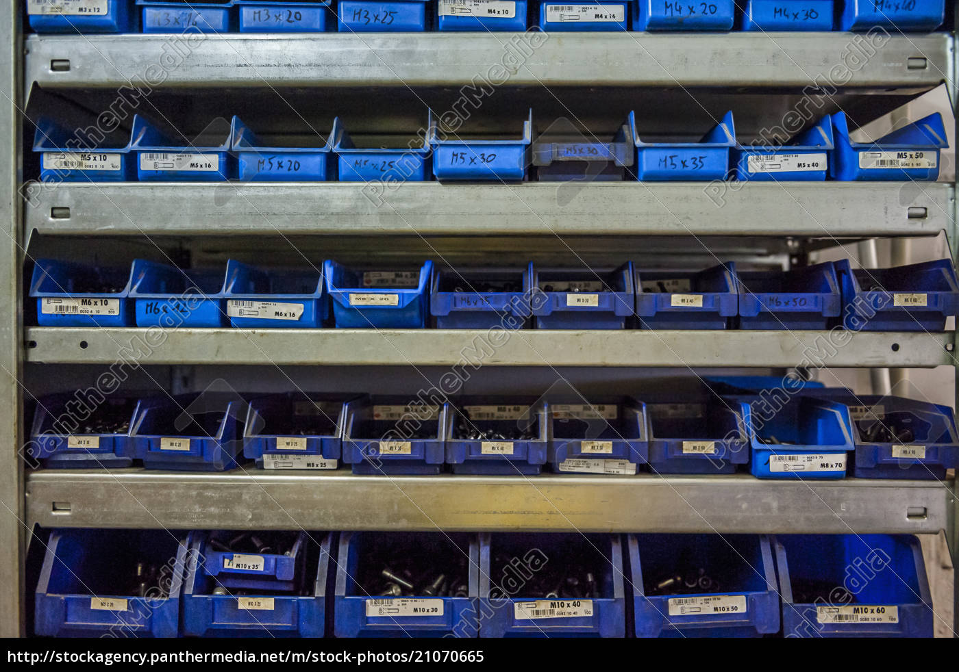 many, boxes, with, screws, in, workshop - 21070665