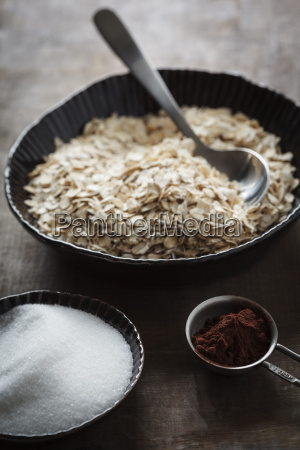 bowls of oat flake sugar and