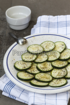 plate of sliced marinated courgette close