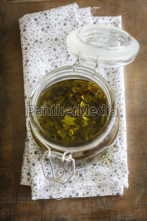 salvia olive oil in jar on