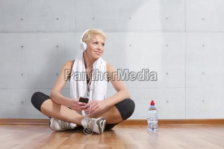 germany brandenburg woman enjoying music with