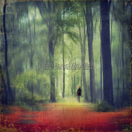person standing in forest composite